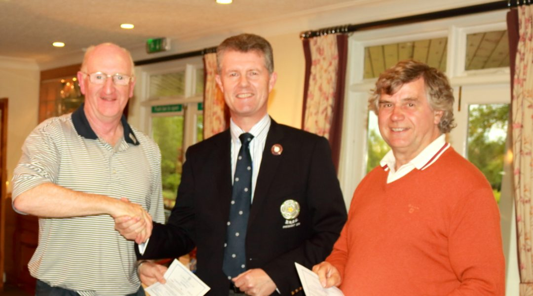 The Yorkshire Union of Golf Clubs President, Mr Jonathan Plaxton, presents second place prizes to Messrs Rishworth and Soppitt